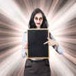 Sinister school teacher holding empty chalk board — Stock Photo