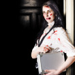 Stock Photo: Dead female zombie worker holding briefcase