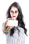 Scary female zombie handing over business card — Stock Photo