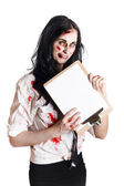 Zombie business woman with clip board — Stock Photo