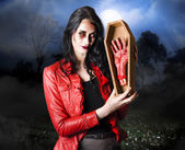 Female grave robber stealing limbs and body parts — Stock Photo
