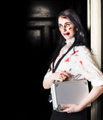 Dead female zombie worker holding briefcase — Stock Photo