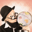 Comical nerdy person kissing the globe — Stock Photo