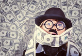 Stressed business man drowning in financial debt — ストック写真