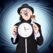 Stock Photo: Nutty professor with clock. Crazy science time