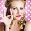 Amercian pinup girl with laundry peg - Stock Photo