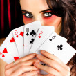 Mysterious female holding deck of playing cards — Stock Photo
