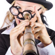 Stock Photo: Businesswomlooking through telescope