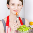 Pretty woman holding salad bowl — ストック写真