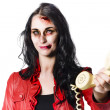 Zombie girl cold calling with dead phone — Stock Photo