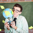Nerd man holding earth world globe in classroom — Stock Photo