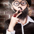 Funny private eye detective smoking pipe - Zdjęcie stockowe