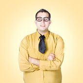 Nice nerd business salesman on yellow background — Photo