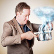 Stock Photo: Businessmwith plcooking up strategic storm