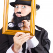 Stock Photo: Womlooking through frame