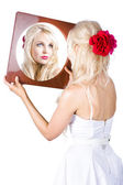 Blond woman looking in mirror — Stock Photo