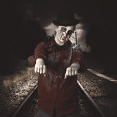 Zombie walking undead down train tracks — Stock Photo