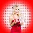 Stunning young blond beauty holding heart present — Stock Photo #26147311