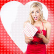 Stock Photo: Surprised attractive girl with heart gift box