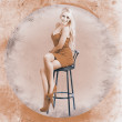 Stock Photo: Happy american style pin-up girl on retro chair