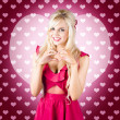Beautiful blonde woman gesturing heart shape — Stock Photo