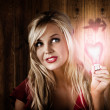Attractive young blond girl holding love light — Stock Photo #26147359
