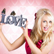 Affectionate blonde woman with love butterflies — Stock Photo