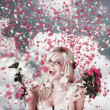 Tender woman with flowers. Romantic celebration — Stock Photo