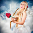 Heavenly angel of love with flower arrow — Stock Photo