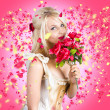 Stock Photo: Sentimental lady with flowers. Falling in love