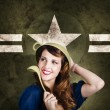 Cute military pin-up woman on army star background — Stock Photo