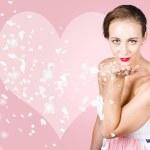 Sensual woman blowing flower petal kiss — Stock Photo