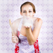 Charming young female cook blowing baking kiss — Foto Stock