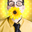 Business man celebrating summer with sun flower — Stock Photo