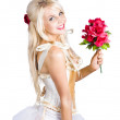 Blond dancing woman with red flowers — Stock Photo