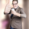 Funny boss giving big thumb up with coffee cup — Stock Photo