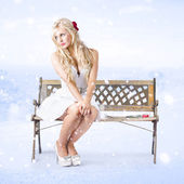 Cold and lonely winter woman sitting all alone — Stock Photo