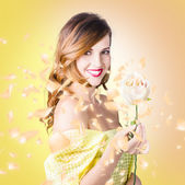 Pretty brunette female holding magic rose blossom — Stock Photo