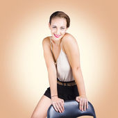 Gorgeous 1950s house wife posing on chair — Stock Photo
