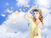 Romantic woman dreaming of a sky filled romance — Stock Photo