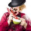 Woman eating bloody hand — Stok fotoğraf