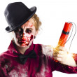 Stock Photo: Isolated zombie womwith dynamite