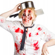 Royalty-Free Stock Photo: Zombie woman with cooking pan on her head