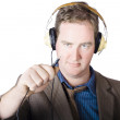 Isolated retro man about to plugin stereo headphones — Stock Photo