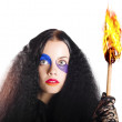 Stock Photo: Staring womholding flame torch
