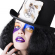 Jester with joker card on hat — Stockfoto