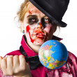 Zombie holding knife in globe - Stock Photo