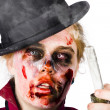 Fearful zombie woman holding blown out candle — Stockfoto