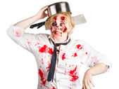 Zombie woman with cooking pan on her head — Stock Photo