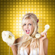 Stock Photo: Blonde girl tangled in funny phone communication